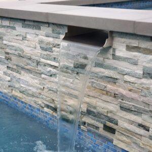 custom spa spillway and stone veneer
